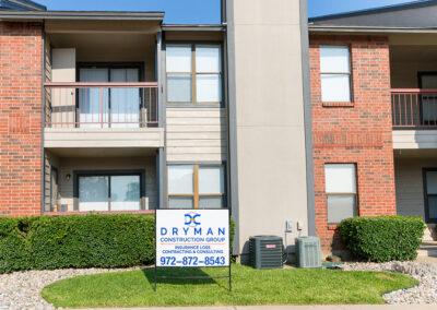 Dryman Construction Sign on Apartment Restoration Job